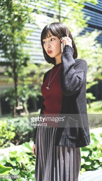 Young woman is talking on a phone seriously