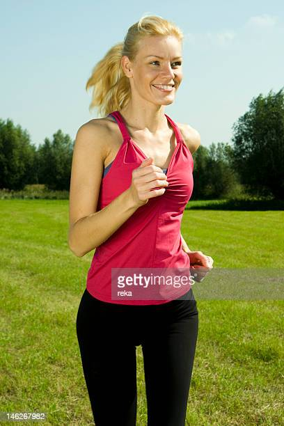 Young woman jogging in meadow