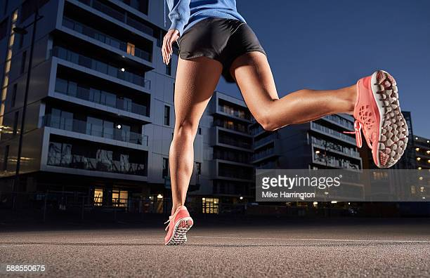 Young woman jogging in urban location.