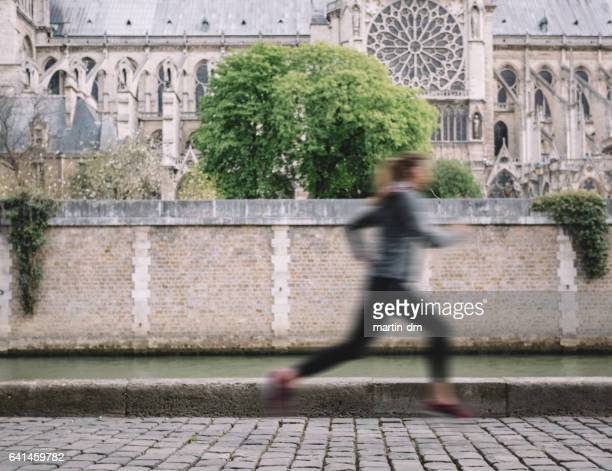Young woman jogging near Seine river