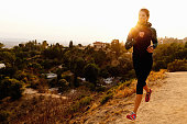 Young woman jogging on dirt track
