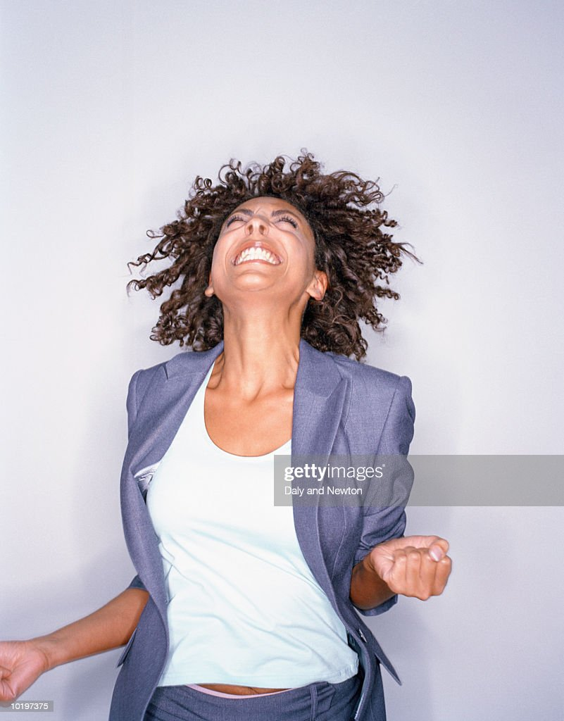 Young woman jumping and smiling