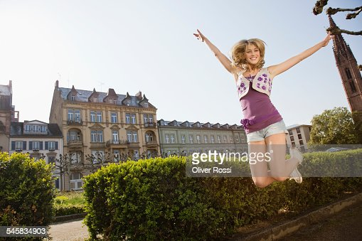 Young woman jumping at university : Stock Photo