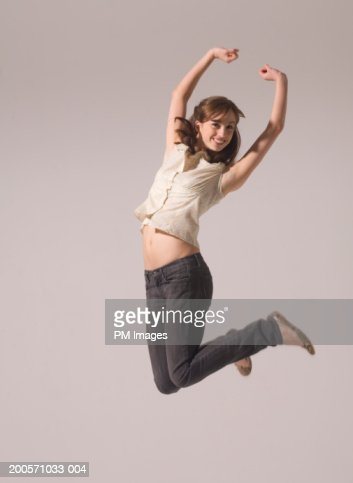 Young woman jumping in air, smiling