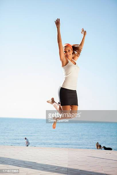 Young woman jumping mid air