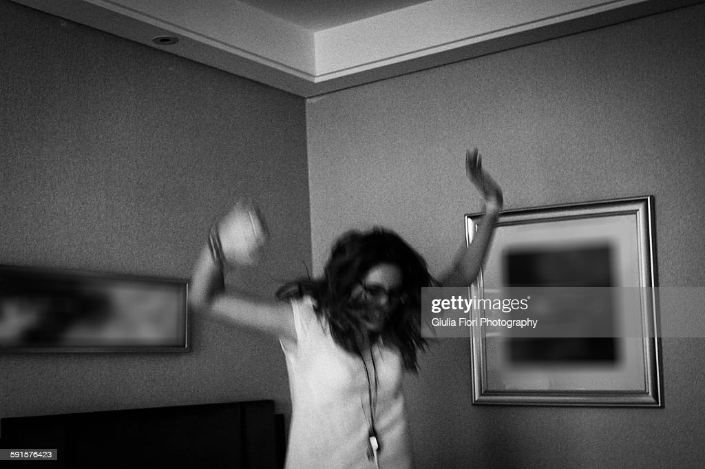 Young woman jumping on bed