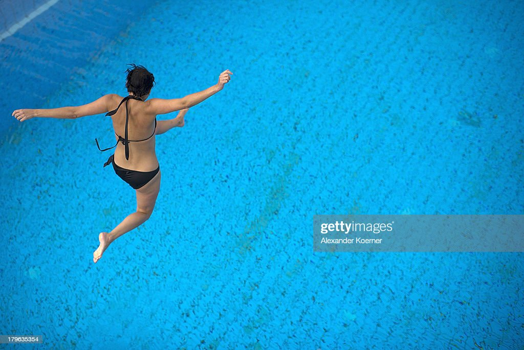 A young woman jumps into a pool early in the morning at Lister Bad on September 6, 2013 in Hanover, Germany. Weather forecast predicts temperatures with heights of 30 Celsius for the weekend accross Germany.