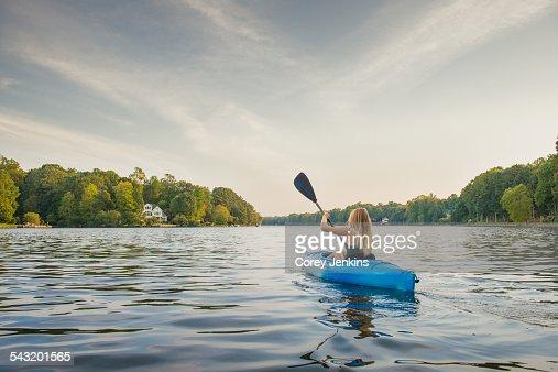 Young woman kayaking on river, Cary, North Carolina, USA