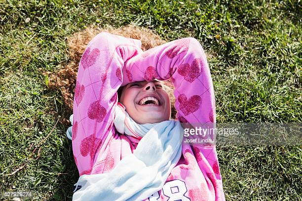 Young woman laughing all loud rolling over floor