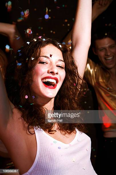 Young woman laughing and dancing  on a party