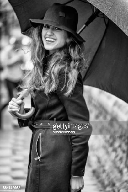 Young Woman Laughing In The Rain