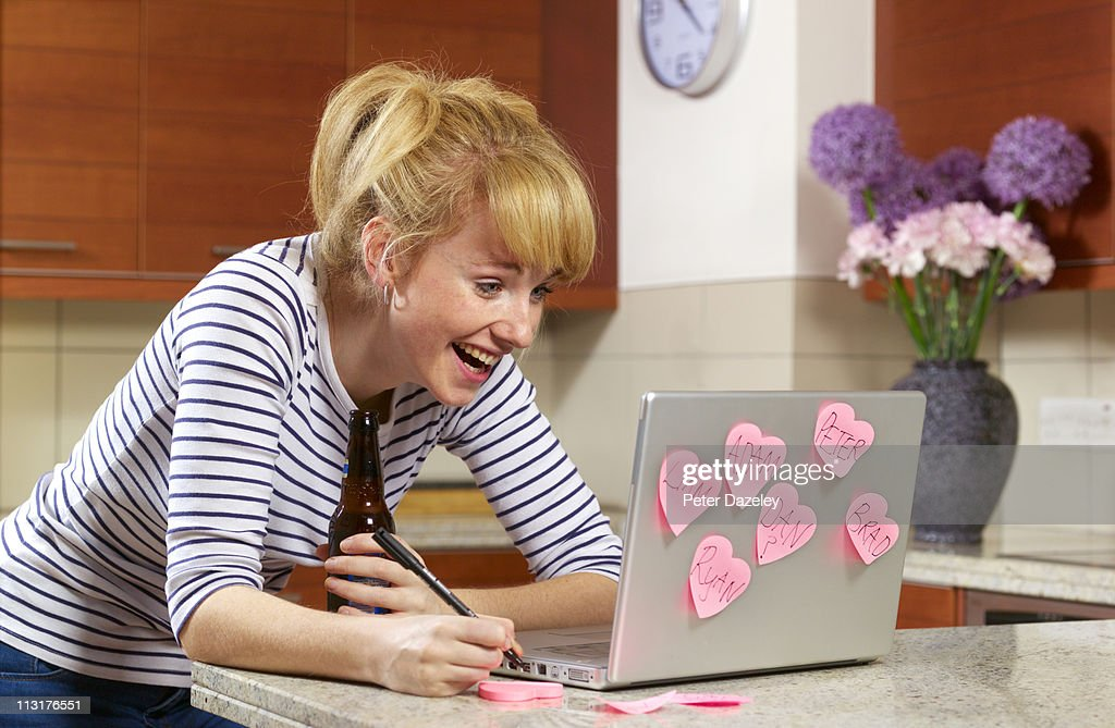 Young woman laughing on dating website : Stock Photo
