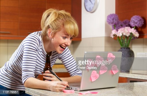 Young woman laughing on dating website