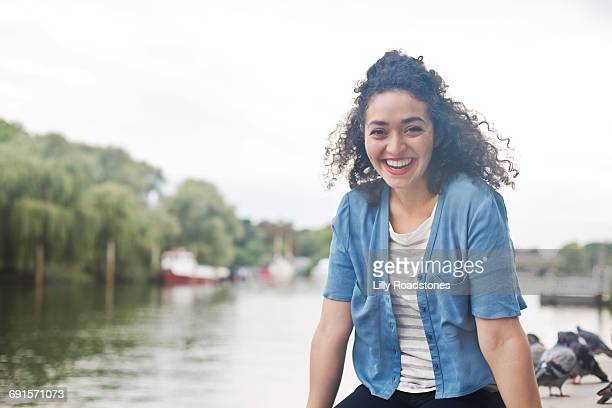 Young woman laughing on the waterside