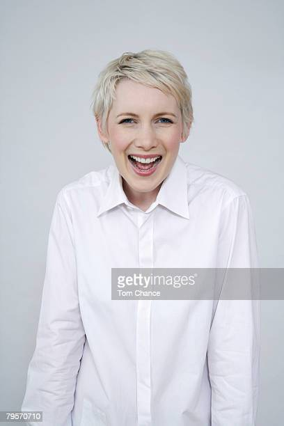 'Young woman laughing, portrait'