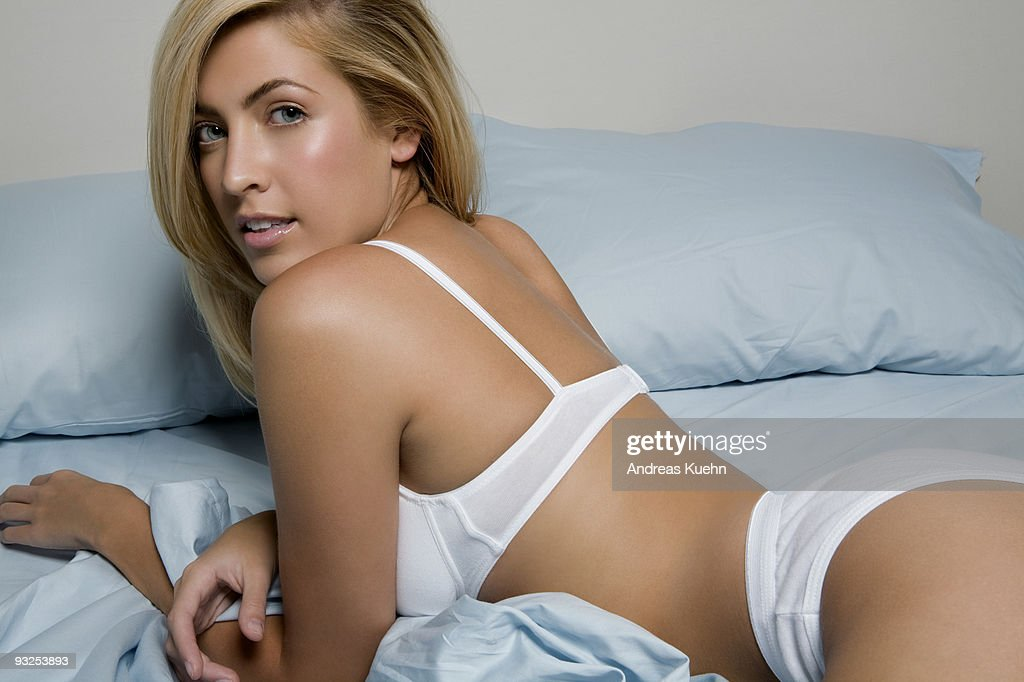 Young woman laying in bed, portrait. : Stock Photo