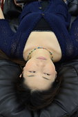 Young woman laying in chair
