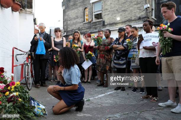 A young woman lays flowers outside the Muslim Welfare House near the scene of the attack by Finsbury Park Mosque on June 19 2017 in London England...