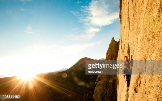 Young woman leading a climbing route in Colorado : Stock Photo