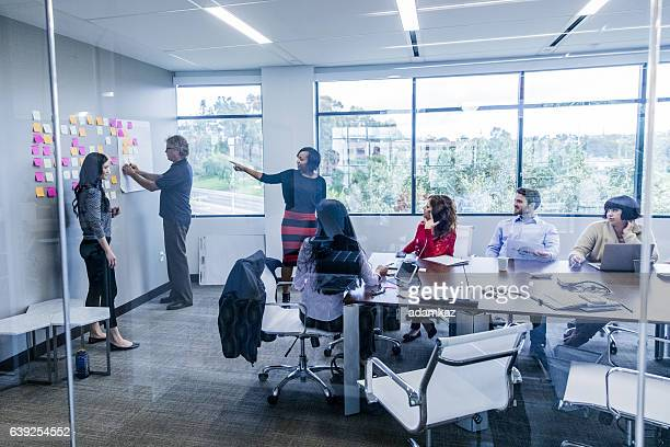 Young Woman Leads a Brainstorming Meeting