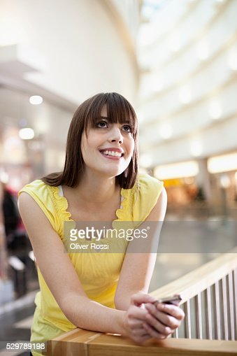 Young woman leaning on a railing : Bildbanksbilder