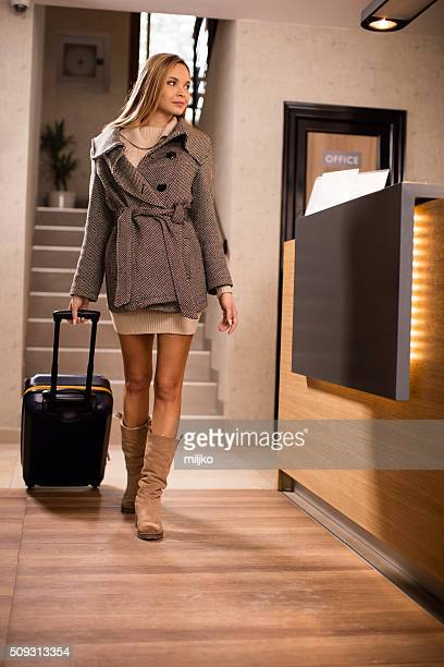 Young woman leaving hotel