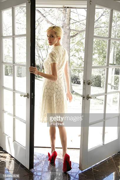 Young Woman leaving through french doors