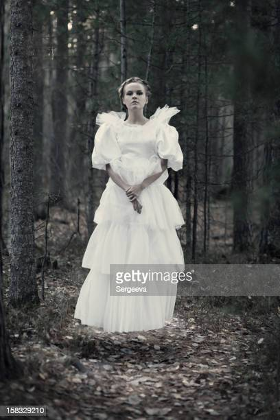 Young woman levitating in the woods