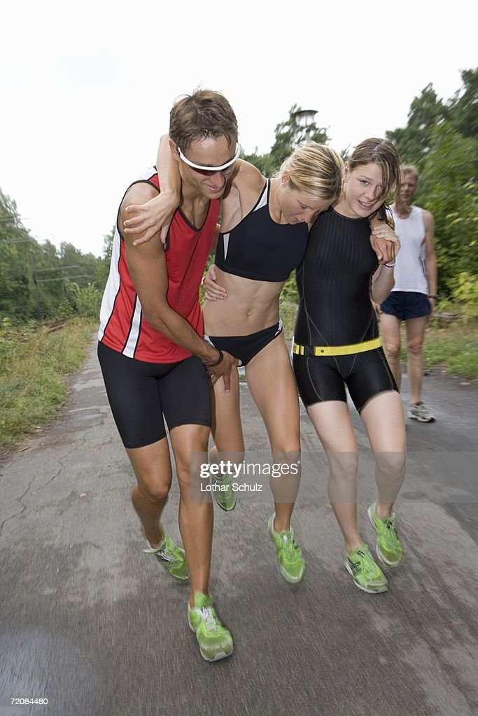 Young woman limping with sports injury
