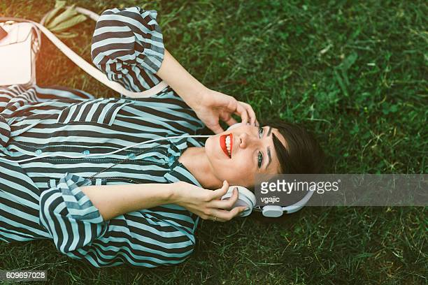 Young Woman Listening Music.