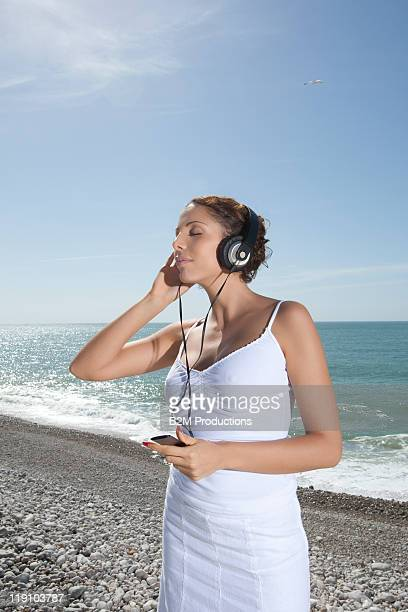 young woman listening to headphone
