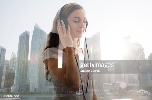 young woman listening to headphones : Stock Photo