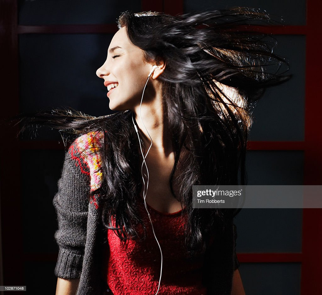 Young woman listening to music. : Stock Photo