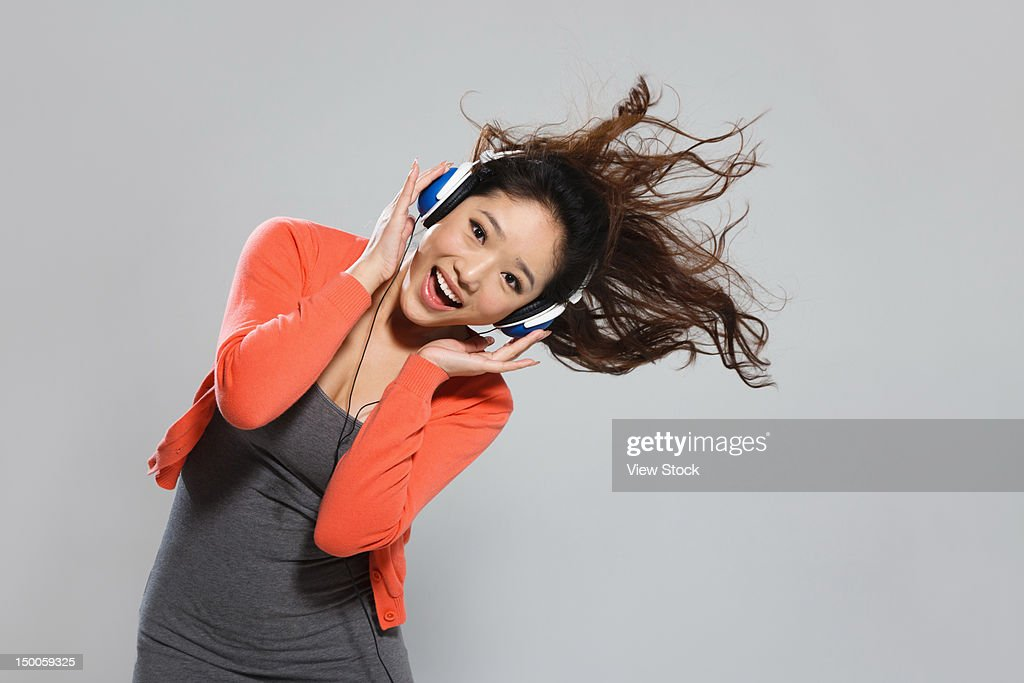 Young woman listening to music : Stock Photo