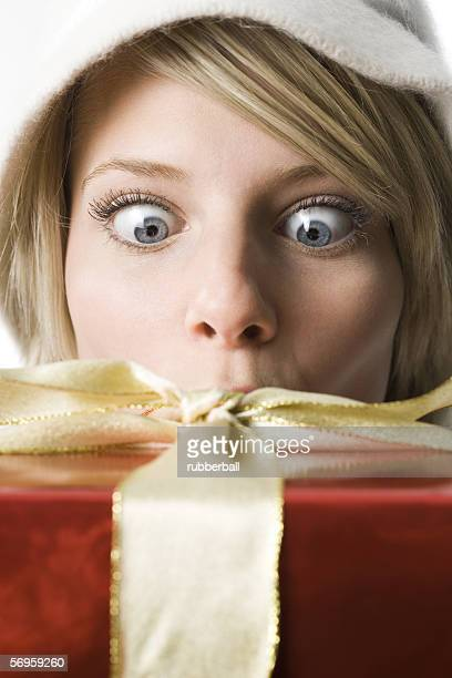 Young woman looking at a gift