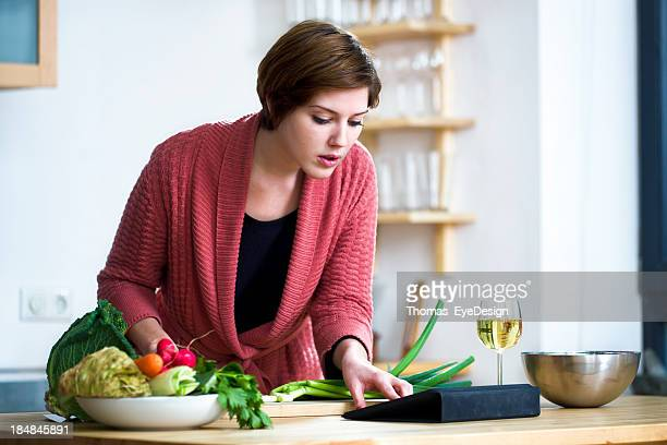 Young woman looking at a  Recipe online