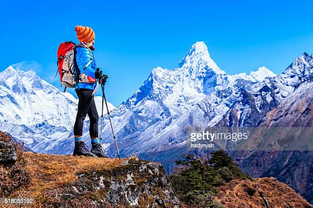 Young woman looking at Ama Dablam, Mount Everest National Park