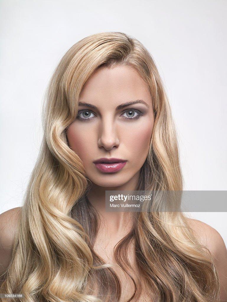 Young woman looking at camera : Stock Photo
