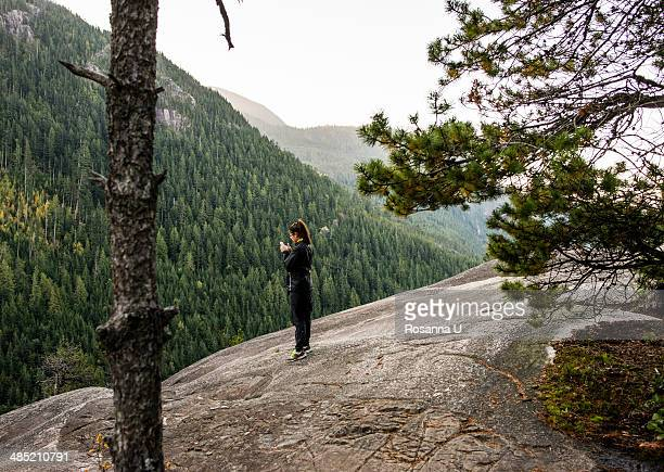Young woman looking at smartphone, Squamish, British Columbia, Canada