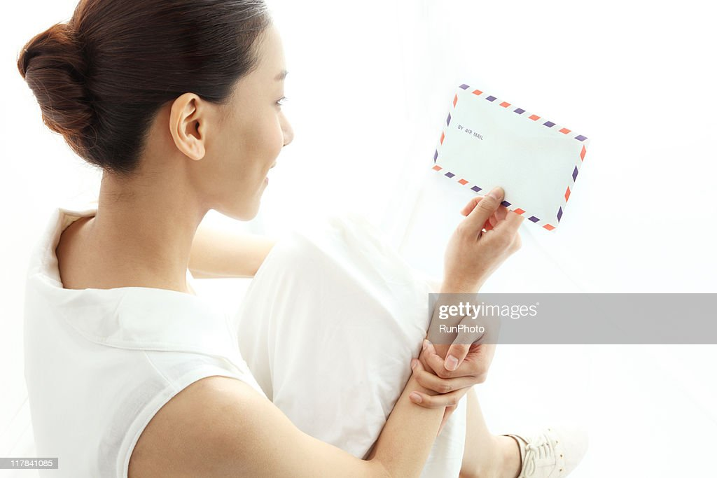 young woman looking at the Air Mail : Stock Photo