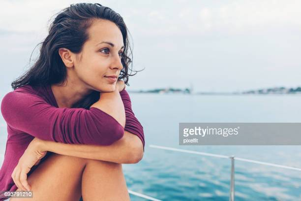 Young woman looking at the view in the see