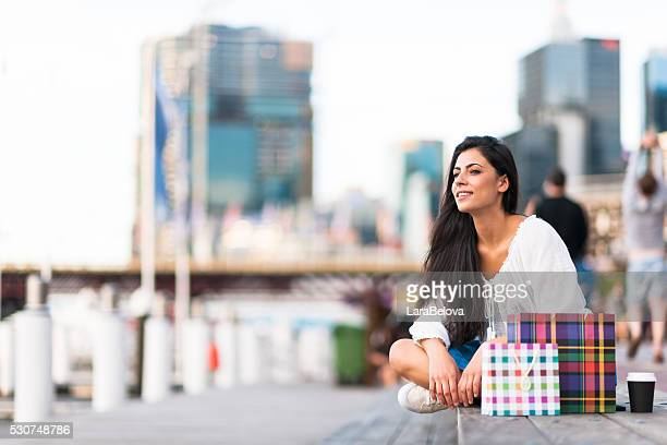 Young woman looking at view in Darling Harbour, Sydney