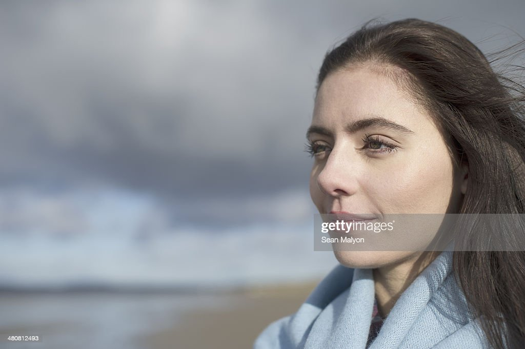 Young woman looking at view : Stock Photo