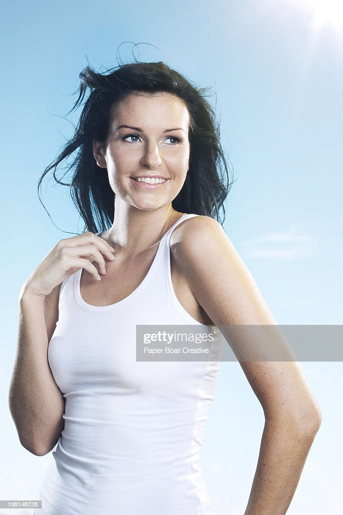 young woman looking away and smiling outdoors : Stock Photo