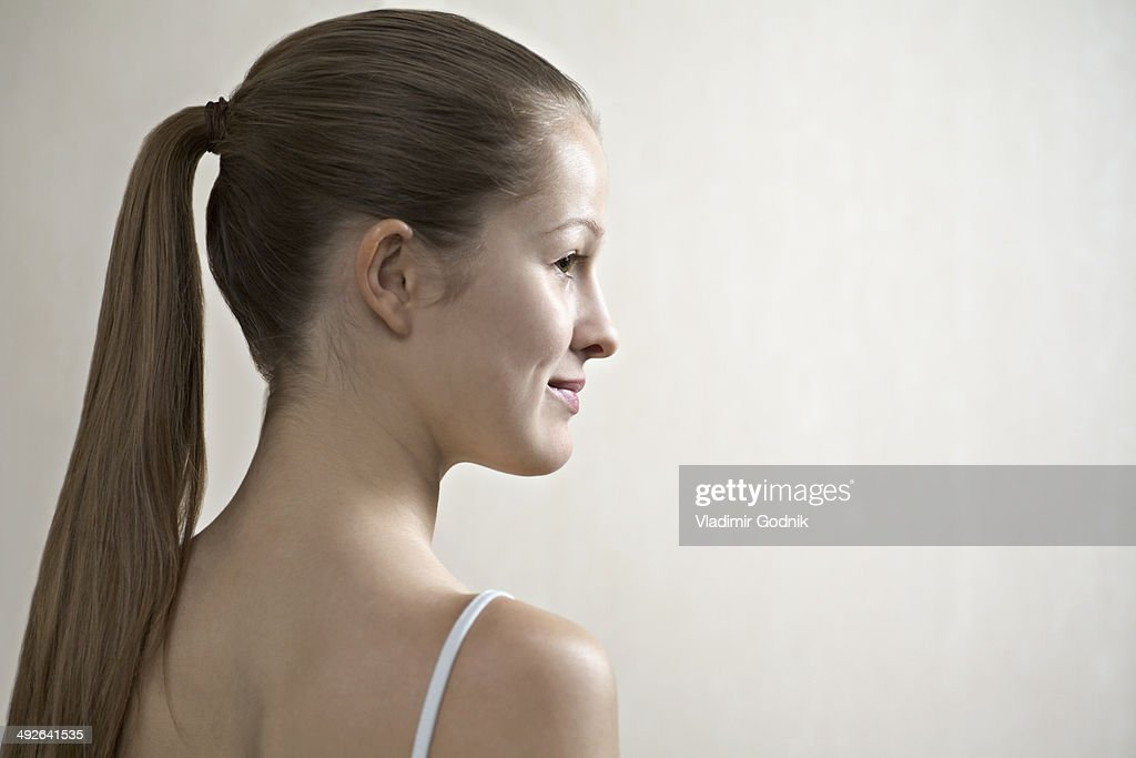 Young woman looking away, smiling : Stock Photo
