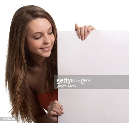 young woman looking down a white sign : Stock Photo