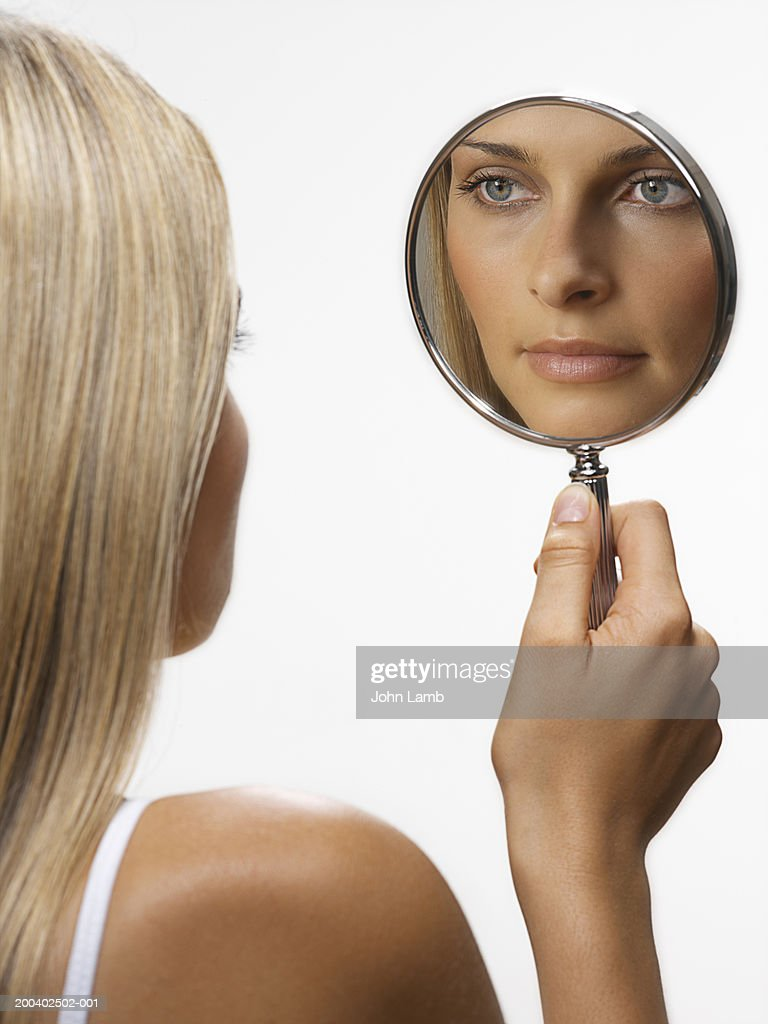 Holding a hand mirror Stock Photos - Page 1 : Masterfile