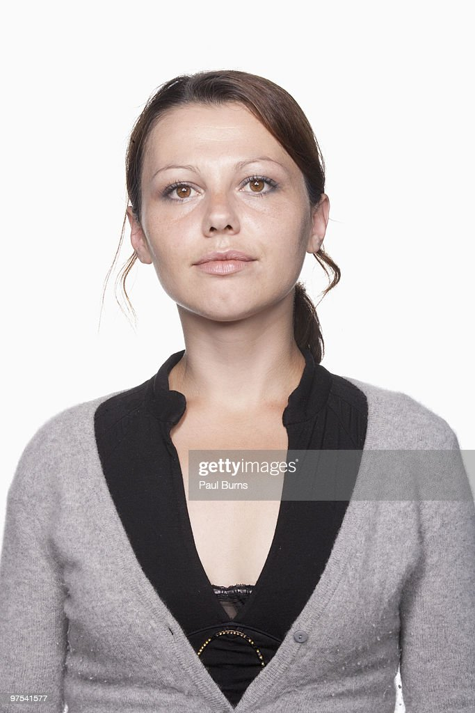 Young woman looking indifferent : Stock Photo