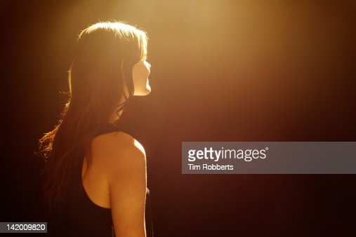 Young woman looking into light. : Photo