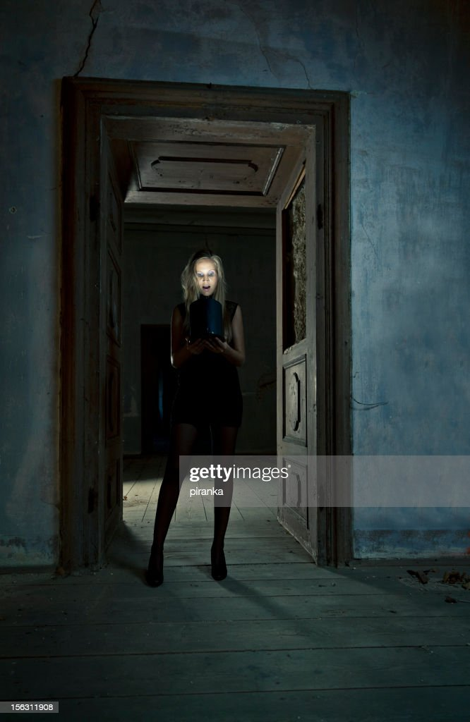 Young woman looking into magic box : Stock Photo